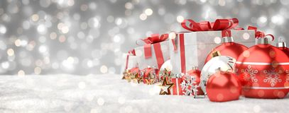 Red and white christmas gifts and baubles lined up 3D rendering. Red and white christmas gifts and baubles lined up on grey snowy background 3D rendering Royalty Free Stock Photography