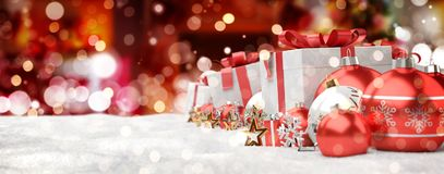 Red and white christmas gifts and baubles lined up 3D rendering. Red and white christmas gifts and baubles lined up on red snowy background 3D rendering Royalty Free Stock Image