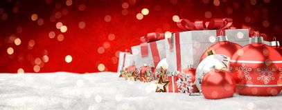 Red and white christmas gifts and baubles lined up 3D rendering. Red and white christmas gifts and baubles lined up on red snowy background 3D rendering Royalty Free Stock Photo