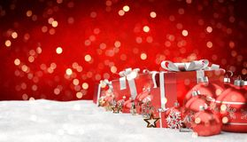 Red and white christmas gifts and baubles lined up 3D rendering. Red and white christmas gifts and baubles lined up on red snowy background 3D rendering Royalty Free Stock Photos