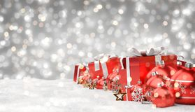 Red and white christmas gifts and baubles lined up 3D rendering. Red and white christmas gifts and baubles lined up on grey snowy background 3D rendering Stock Image