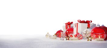 Red and white christmas gifts and baubles on snow 3D rendering. Red and white christmas gifts and baubles on snowy background 3D rendering Royalty Free Stock Photography