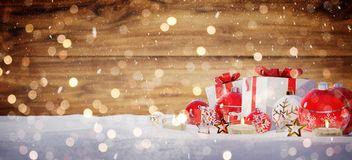 Red and white christmas gifts and baubles on snow 3D rendering. Red and white christmas gifts and baubles on snowy background 3D rendering Royalty Free Stock Image
