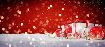 Red and white christmas gifts and baubles on snow 3D rendering. Red and white christmas gifts and baubles on snowy background 3D rendering Stock Images