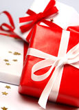 Red and white Christmas gifts on white background Stock Photos