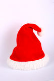 Red and white Christmas hat. On white background Stock Photography