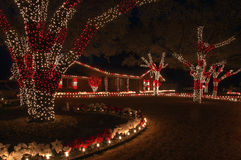 Red and White Christmas Lights. Red and white holiday lights is the color theme for this home and yard Stock Photos