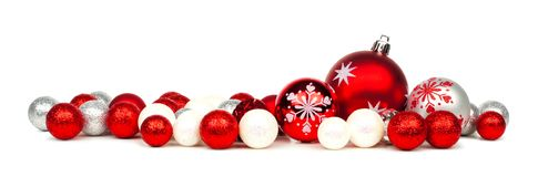 Red and white Christmas ornament border. Long Christmas border of red and white ornaments over a white background Royalty Free Stock Images
