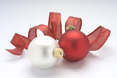 Red and white Christmas ornaments. With ribbon Stock Image