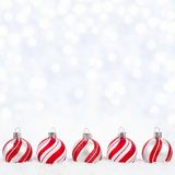 Red and white Christmas ornaments in snow with twinkling background Stock Image