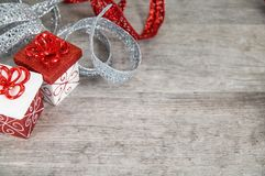 Red and white Christmas packages with glittery ribbon royalty free stock images