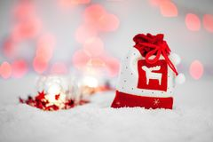 Red and White Christmas Pouch Bag on White Textile Stock Image
