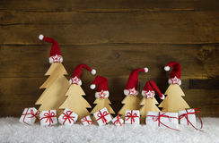 Red white christmas presents with handcrafted trees on old woode Royalty Free Stock Photography