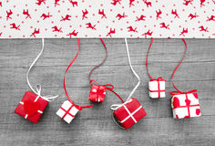 Red and white Christmas presents on a wooden background in count stock photo