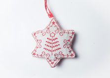 Red and white christmas star toy isolated on white Royalty Free Stock Image