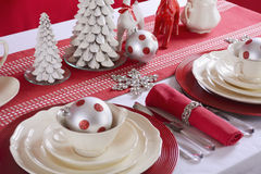 Red and White Christmas Table Setting. Royalty Free Stock Image