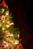 Red and white christmas tree with ornaments balls Royalty Free Stock Images