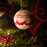 Red and white christmas tree with ornaments balls Royalty Free Stock Photography