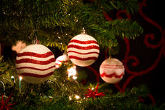 Red and white christmas tree with ornaments balls Stock Photography