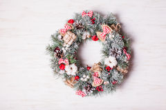 Red and white Christmas wreath. With bows and cotton flowers stock images