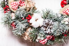 Red and white Christmas wreath. With bows and cotton flowers royalty free stock photography