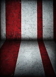 Red and White Circus Tent Background. Old grunge red and white stripes painted on a concrete wall of circus building, background Stock Images