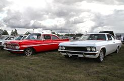 Red and white classic cars. At Pick-Nick 2018, Classic car show in Forssa, Finland. 05.08.2018 Forssa, Finland american auto automobile automotive chevrolet stock photography