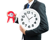 Red and white clock holding in businessman hands isolated Royalty Free Stock Images
