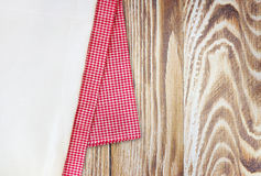Red & white cloth on wooden background with empty space. Stock Image