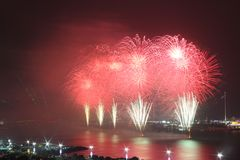 Red and white coastal firework display Stock Image