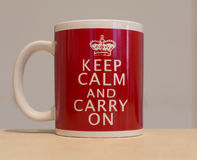 Red and white coffee cup with message Stock Images