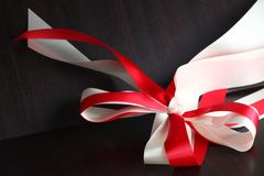 Fabric ribbon scene. The red and white color fabric ribbon represent the gift and present background concept related idea Royalty Free Stock Images