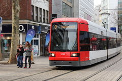 Modern tram in Bremen, Germany. A red-white colored modern tram running through Bremens pedestrian zone, Germany Stock Image