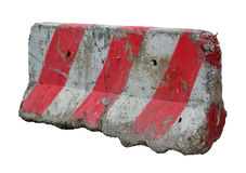Red and white concrete barriers blocking the road. Royalty Free Stock Image