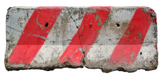 Red and white concrete barriers blocking the road. Stock Images