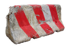 Red and white concrete barriers blocking the road. Royalty Free Stock Photography