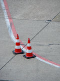 Red-white cones with red-white line Stock Photo