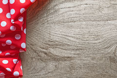 Red white cotton folded polka-dot fabric on wooden board.  Royalty Free Stock Image