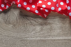 Red white cotton folded polka-dot table cloth on wooden board.  Royalty Free Stock Photos