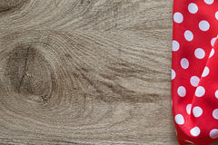 Red white cotton folded polka-dot tablecloth on wooden board hor. Izontal view Royalty Free Stock Photo