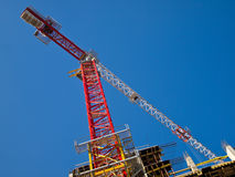 Red and white crane gibbet on blue sky Stock Image