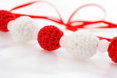 Red and white crocheted beads. Ribbon of red and white crocheted beads Royalty Free Stock Photo
