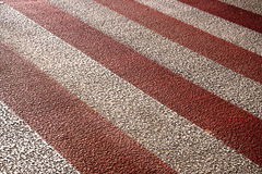 Red and white crossing. Red and white pedestrian crossing background Stock Photo