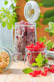 Red white currants gooseberries jars preparations Stock Photography