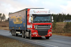 Red and White DAF XF Semi Trailer Truck on the Road Stock Photos