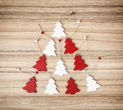 Red and white decorative christmas trees on the wooden backgroun Stock Image