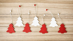 Red and white decorative little christmas trees on the wooden ba Royalty Free Stock Photos