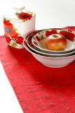 Red&white dishware. Dishware with red&white floral pattern of poppy on red linen Stock Photography
