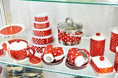 Red with white dots dishes in store. Red with white dots dishes in a hardware store Royalty Free Stock Image