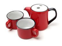 Red with white dots teapot and cup. Isolated on white background royalty free stock photo